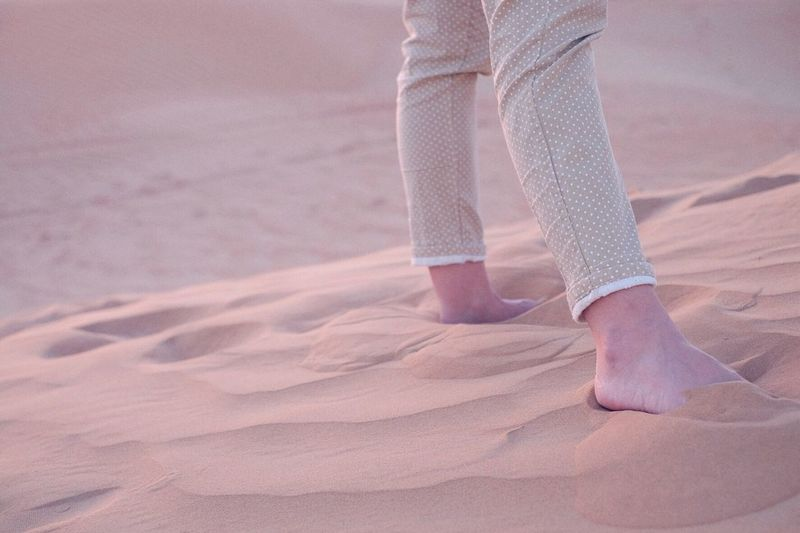 Woman Standing On Sand