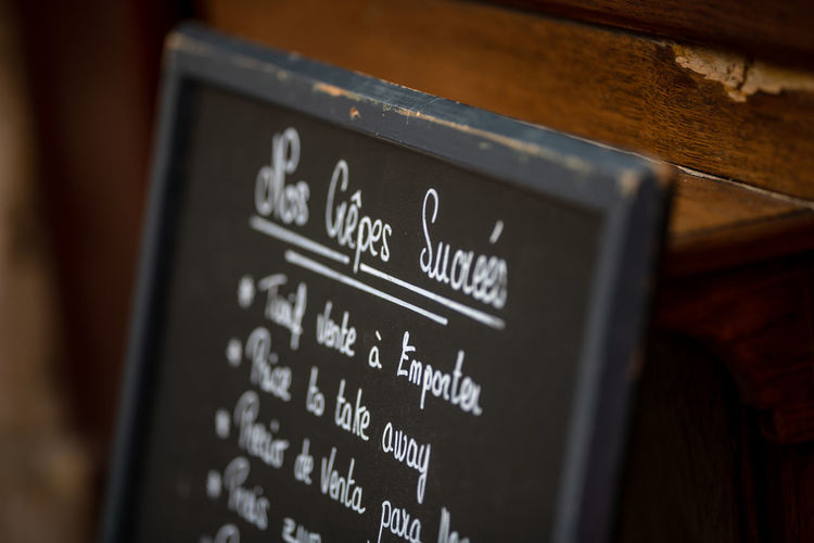 Close-up of information sign board in restaurant
