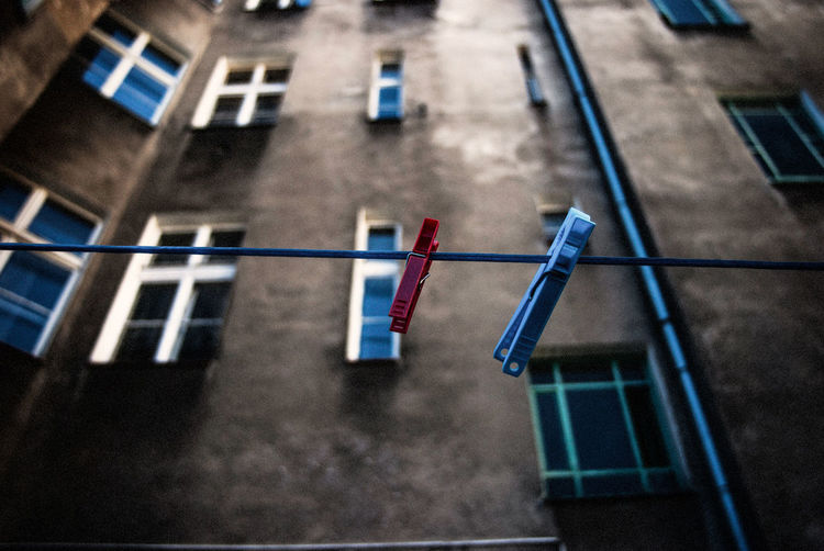 Low Angle View Of Clothes Line With Pegs