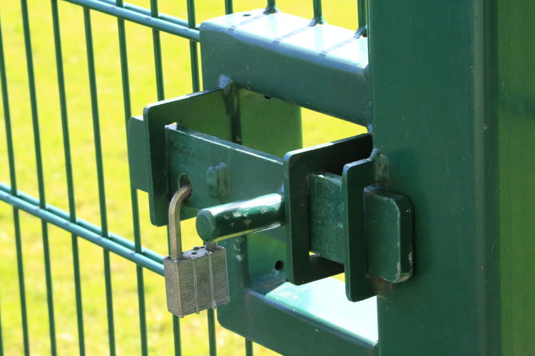 Locked gate Lines And Angles Lines And Angles Locked Gate Green Gate Close-up Green Color Latch Closed Door Door Handle Front Door Padlock Locked Door Door Door Closed Lock