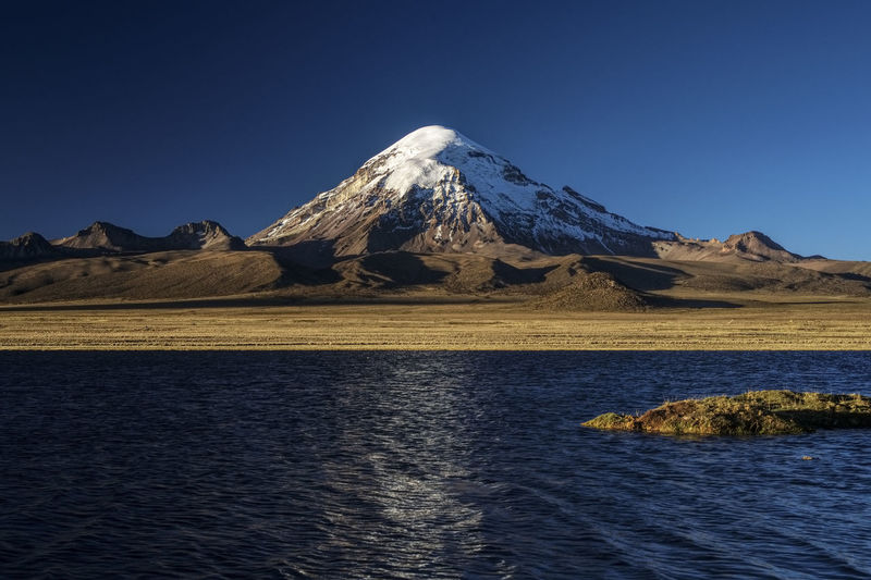 Vulcano Snowcapped Mountain Vulcan Landscape Blue Environment Tranquil Scene Clear Sky Nature Water Mountain Mountain Peak Volcano Tranquility Lake Bolivia Sajama Reflection