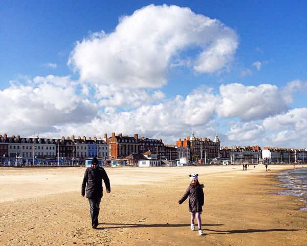 A walk on the beach Walking Walk Beach Beach Walk Father And Daughter Family Family Time Holiday Spring England English Beach Shoreline Shore Ocean Seaside Blue Sky White Clouds Seafront Beach Waves  Seafront Houses Weymouth
