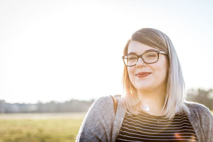 Glasses Portrait Eyeglasses  One Person Front View Young Adult Headshot Sky Lifestyles Hairstyle Real People Young Women Smiling Nature Focus On Foreground Hair Casual Clothing Day Outdoors Beautiful Woman