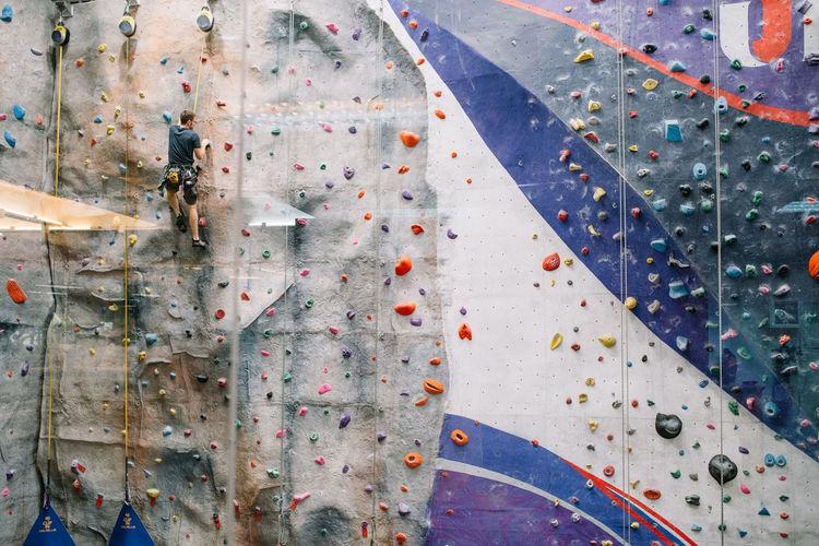 Indoor Rock Climbing Adventure Balance Challenge Climbing Climbing Wall Determination Exercising Extreme Sports Gripping Gym Health Club Healthy Lifestyle Indoor Rock Climbing Indoors  Leisure Activity Lifestyles Practicing Recreational Pursuit Rock Climbing Sport Strength