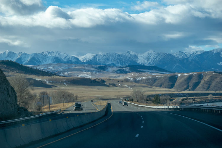 Aerial view of highway and mountains against sky