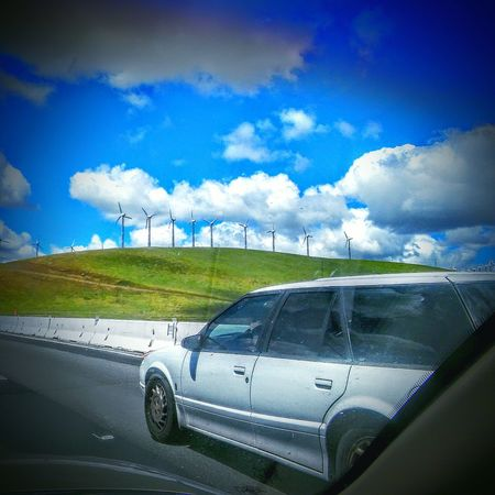 Driving Road Side View Highway 580 Taking Photos Clouds And Sky Wind Turbines On A Field Wind Turbine My Point Of View Wind Power Telling Stories Differently This Week On Eyeem SUV Freeway Scenery Check This Out Blue Sky Green Hillside Green La