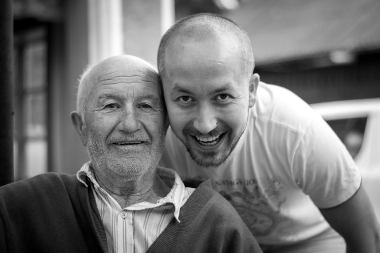 Close-Up Portrait Of Cheerful Grandfather With Grandson