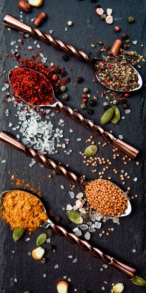 High angle view of spices in spoon on slate