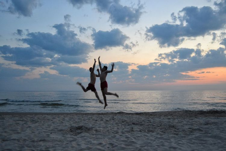 Water Sea Beach Togetherness Sunset Men Sky Horizon Over Water Jumping Energetic Mid-air Wave