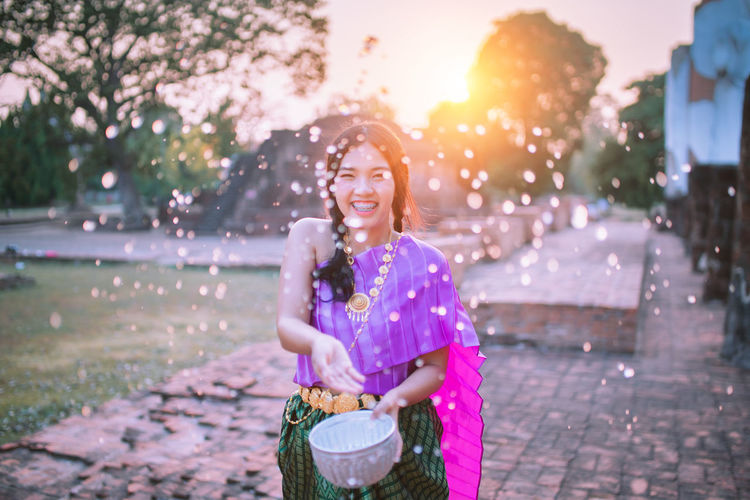 Happy Songkran Festival Thailand. 🇹🇭 One Person Women Smiling Real People Container Happiness Three Quarter Length Casual Clothing Nature Front View Lifestyles Young Adult Girls Basket Standing Females Child Emotion Leisure Activity Outdoors Innocence Light Light And Shadow Lighting Equipment Lights Lighthouse Sun Sunset Sunlight Sunrise Sunset_collection Portrait Hanging Out Happiness Happy Happy People Happy :) Happy Time Songkran Songkran Festival Songkran Thailand Songkran Festival Day Festival Festival Season Festival Of Lights Festival Goer Thailand Thailand_allshots Thailandtravel Thailand Photos