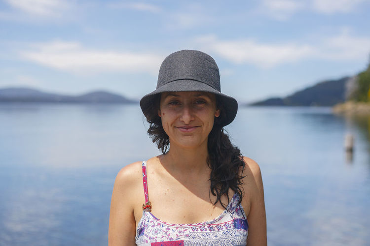 Portrait of young woman on lake Nahuel Huapi, spring 2016 Adult Adults Only Beach Close-up Confidence  Day Front View Happiness Headshot Lake Leisure Activity Looking At Camera One Person One Woman Only Only Women Outdoors People Portrait Portrait Of A Woman Smiling Vacations Waist Up Water Young Adult