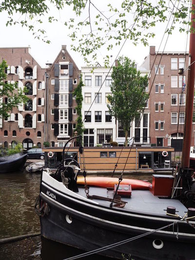 Amsterdam Amsterdam Canal Amsterdamcity Amsterdamse Grachten Architecture Building Exterior Built Structure Canals Canals And Waterways City City City Life Cityscape Cityscapes Day Houseboat Houseboats In Amsterdam No People Outdoors Sky Summer Transportation Travel Destinations Tree Water