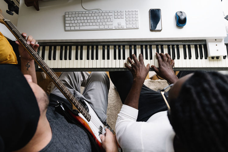 High angle view of males working on music