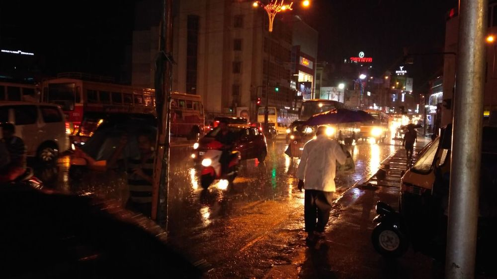 City Street Night Street Wet Car City Life People Trivandrum TrivandrumdiariesLand Vehicle City Illuminated Road Adult Adults Only Outdoors Men Large Group Of People Only Men First Eyeem Photo India Kerala Kerala The Gods Own Country ;)