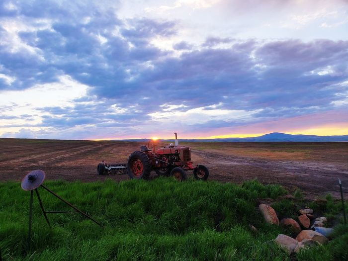 EyeEmNewHere Vivid Agriculture Field Farm Prairie Prairie Scenes Rural Beauty In Nature Countryside Country Country Living Combine Harvester Farmer Crop  Water Tractor Agricultural Equipment Agricultural Machinery Rice - Cereal Plant