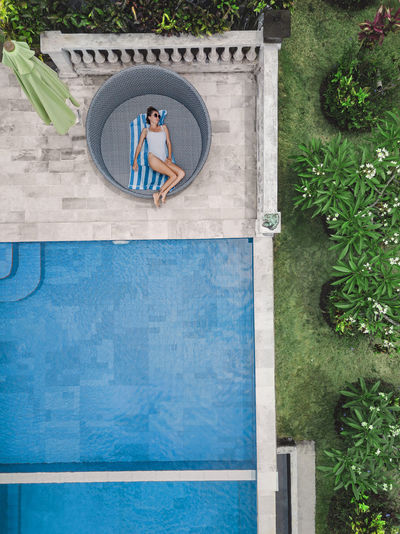 People standing by swimming pool in yard