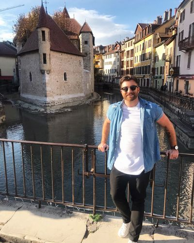 Annecy 🇫🇷 Architecture Building Exterior Built Structure Portrait Looking At Camera Front View Casual Clothing One Person Standing Smiling Full Length Railing Real People Mid Adult Water Outdoors Leisure Activity Lifestyles Day Happiness Annecy La Venise Des Alpes France 🇫🇷 Annecy Annecy Le Vieux Annecy, France