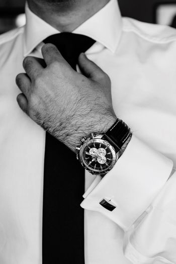 It's time Black And White Photography Black And White Business Man Wedding Preparation Wedding Day Tail Man Watches Watches Human Hand Hand Jewelry Human Body Part Real People One Person Close-up Body Part Fashion Indoors  Diamond - Gemstone Ring Lifestyles White Color Focus On Foreground Human Finger Finger Adult Celebration Personal Accessory The Modern Professional EyeEmNewHere