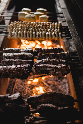 Close-up of burning candles on barbecue grill