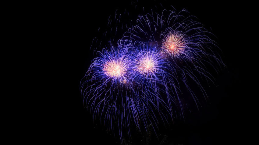 Arts Culture And Entertainment Black Background Blue Celebration Copy Space Cut Out Dark Event Firework Glowing Illuminated Indoors  Motion Nature Night No People Purple Sky Sparks Studio Shot