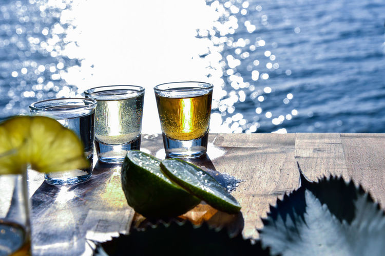 Tequila by the Sea Agave Alcohol Alcoholic Drink Citrus Fruit Close-up Drinking Fiesta, Focus On Foreground Freshness Lemon Lime Liquid Mexico Refreshment Seaside Selective Focus Still Life Sunset Tequila Yellow Found On The Roll