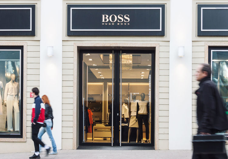People Store City Lifestyles Pedestrian Building Exterior Retail  Store Window Urban Hugo Boss Fashion Clothing Store Shopping Designer Clothes Luxury Shop