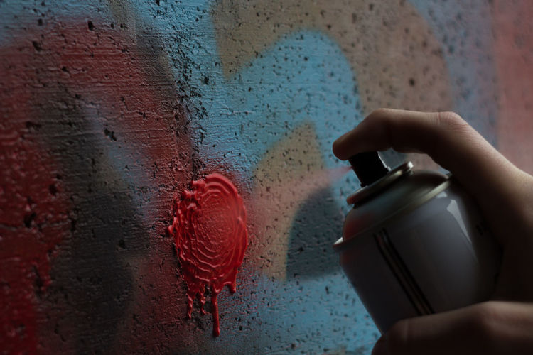 Can Close-up Color Cropped Day Detail Graffiti Hand Holding Lifestyles Light And Shadow Paint Person Real People Red Spray Things I Like Wall Wet My Favorite Photo