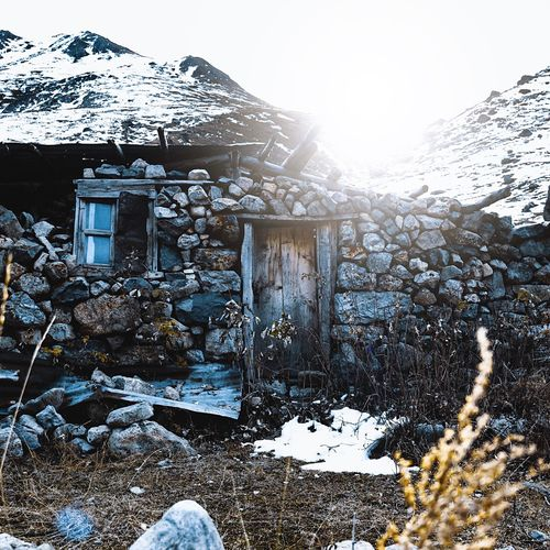 Ruined EyeEmNewHere Winter Snow Cold Temperature Nature Building Exterior Architecture Built Structure Sky Day Sunlight House No People Outdoors Clear Sky Plant Environment Mountain