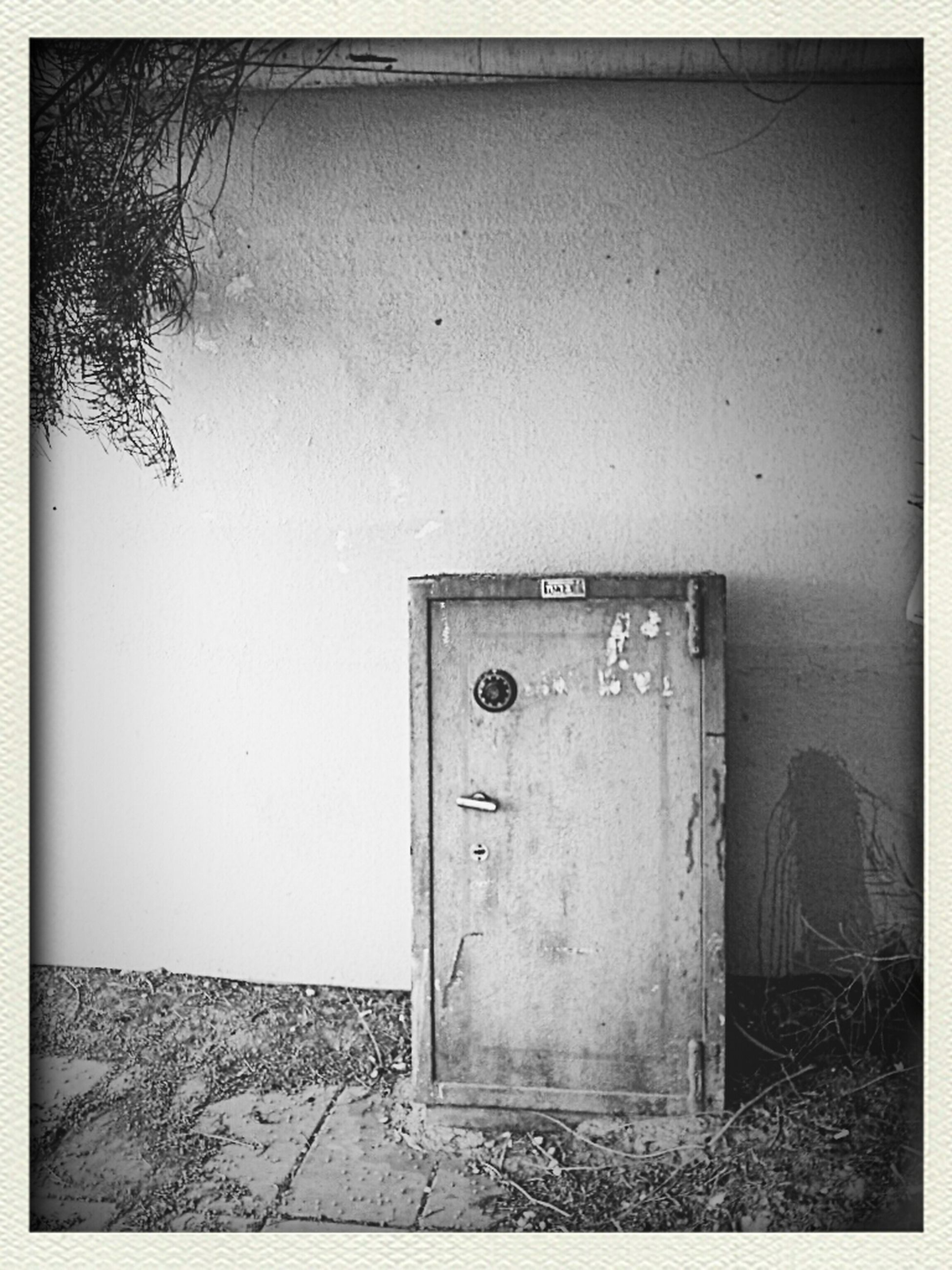 transfer print, auto post production filter, wall - building feature, door, built structure, wall, architecture, indoors, abandoned, closed, text, communication, old, no people, western script, house, day, safety, protection, copy space