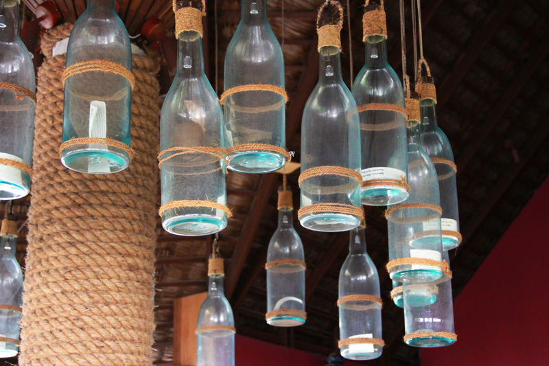 Glass - Material Transparent Bottle Container No People Indoors  Close-up Glass Decoration Restraunt Decor Ceiling Art Ceiling Design Ceiling Decorations Ceiling Decor Wishing Bottle Handmade Glass Bottle