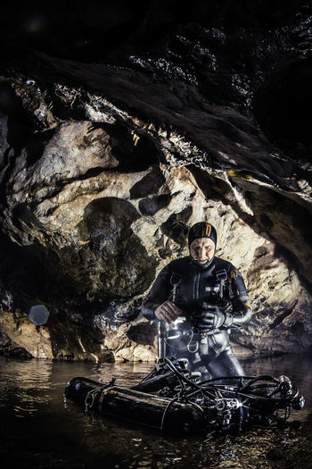 Cave underwater exploration Adult Adventure Cave Cavediver Cavediving Courage Discovery Diving Equipment Diving Suit Equipment Extreme Sports Front View Karst Limestone Nature One Person Outdoors People Portrait Scuba Diving Underground Underwater Underwater Diving Water Wetsuit