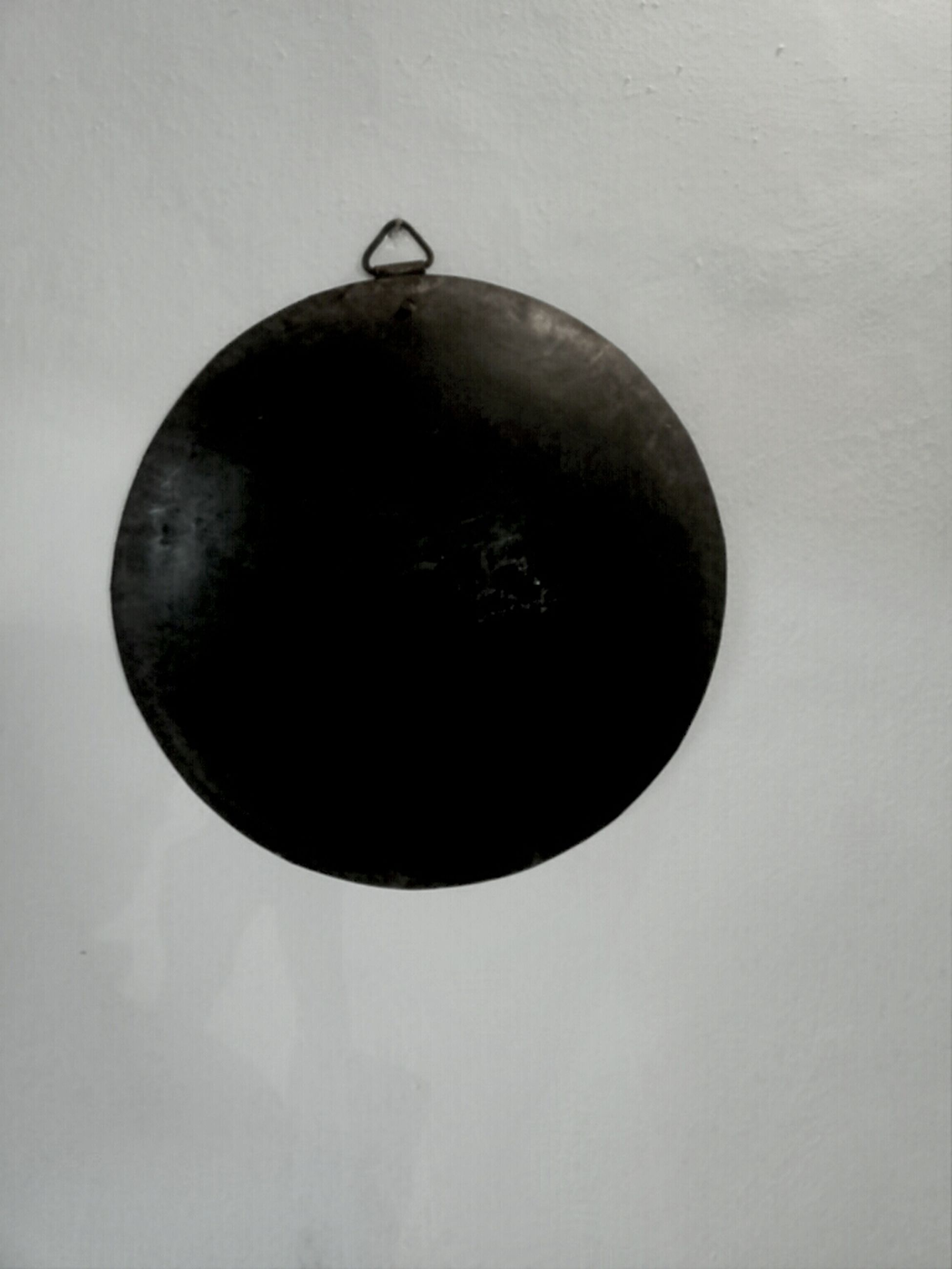 circle, low angle view, indoors, single object, copy space, close-up, geometric shape, sphere, still life, no people, wall - building feature, metal, round, lighting equipment, hanging, shape, reflection, black color, directly above, circular