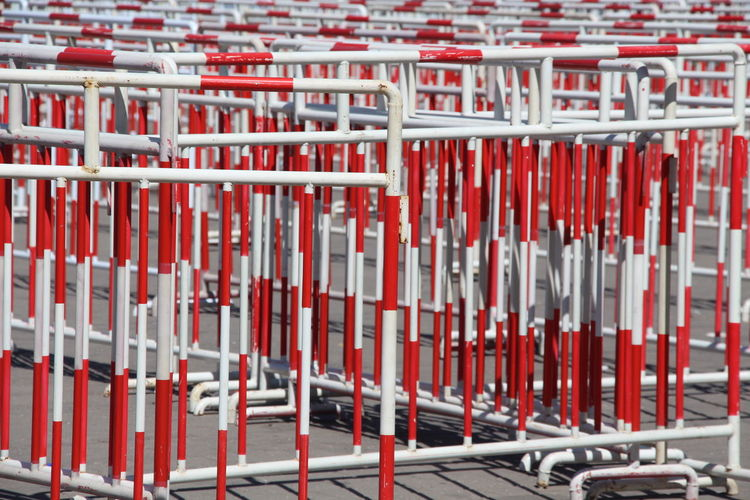 Barrier Arrangement Bars Forbidden Full Frame In A Row Large Group Of Objects Pattern Pattern Pieces Pattern, Texture, Shape And Form Pole Railings Red Side By Side Signs Still Life Stop