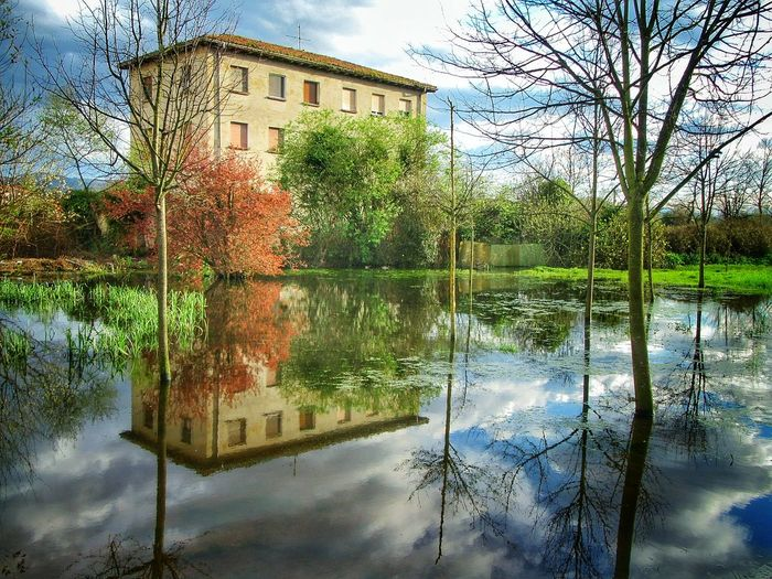Architecture Bare Tree Branch Building Exterior Built Structure Cloud Cloud - Sky House Lake Lumicar Nature Outdoors Reflection Showcase April Sky Standing Water Tranquil Scene Tranquility Tree Water Waterfront