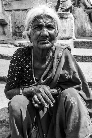 If begging should unfortunately be thy lot, knock at the large gates only. Struggle For Life Adult Adults Only Beggar In The City Day Grandmother Gray Hair Indiastreetphotography Love To Take Photos ❤ One Person One Senior Woman Only Outdoors People Real People Senior Adult Senior Women Sitting Statue Street Photography Streetphotography Struggle For Existence Women