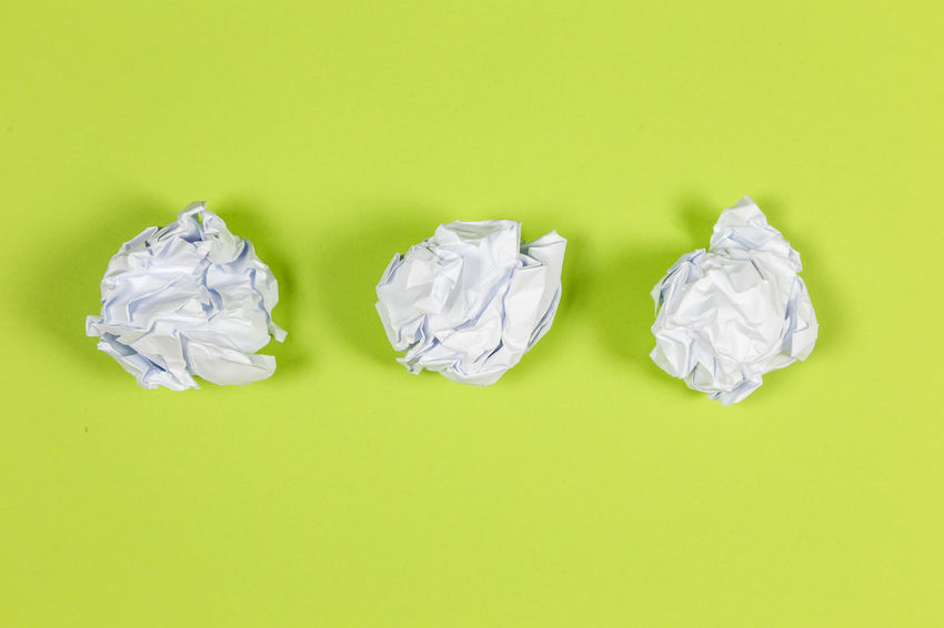 Crumpled Crumpled Paper Colored Background Studio Shot Paper Garbage Green Background Copy Space Crumpled Paper Ball Indoors  No People Green Color White Color Negative Emotion Creativity Frustration Recycling High Angle View Emotion