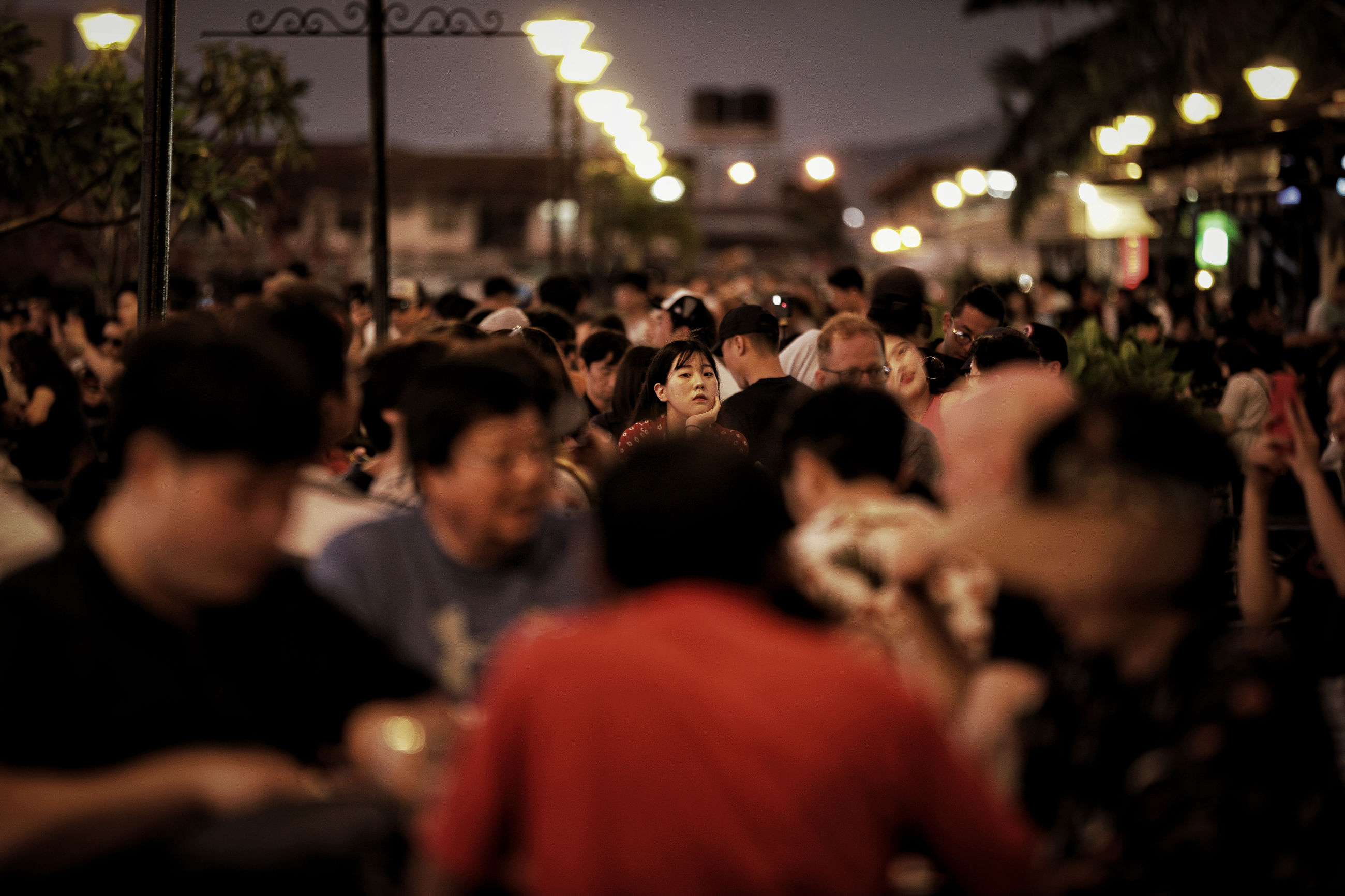 crowd, large group of people, real people, group of people, men, illuminated, women, lifestyles, adult, leisure activity, architecture, togetherness, selective focus, enjoyment, outdoors, lighting equipment, city, night, street, nightlife, spectator, stage, excitement