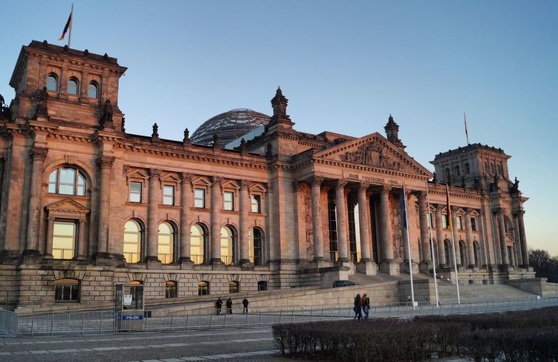 Architecture Building Exterior Built Structure Travel Destinations Tourism Travel Clear Sky History City Real People Sky Tourist Façade Statue Architectural Column Outdoors Sculpture Large Group Of People Day Pediment reichtag Berlin Reichstag Demdeutschenvolke The City Light
