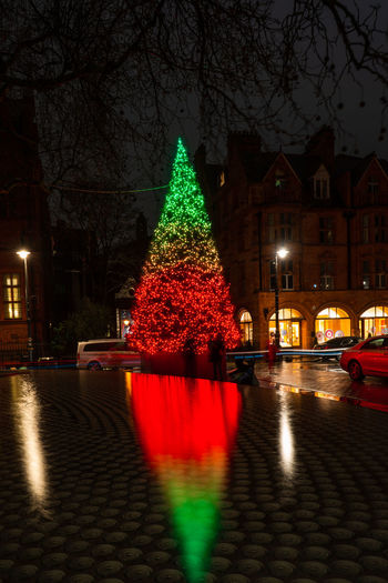 LONDON - DECEMBER 23, 2018: The Connaught hotel's iconic Christmas tree on Mount Street in Mayfair, London is designed by celebrated conceptual artist Sir Michael Craig-Martin. Tree Illuminated Christmas Building Exterior Night Architecture christmas tree Built Structure City Celebration Christmas Decoration Holiday Decoration Street Christmas Lights Holiday - Event Transportation Mayfair Mount Street London Color