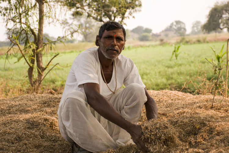 indian farmer at work.... Aged Portrait Farmer Saw Dust Indian Farmer Farmer Farm India Parbhani One Man Only Adult Only Men Men One Person Adults Only Social Issues People Outdoors Rural Scene Day Nature Young Adult This Is Masculinity Inner Power A New Beginning