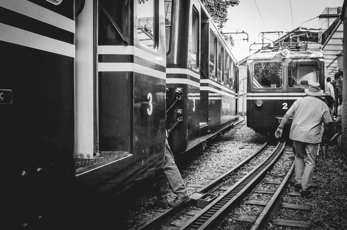 A man refurbishes a train wagon that carries tourists at the Corcovado Christ (april 2017) The Street Photographer - 2017 EyeEm Awards Rail Transportation Transportation Train - Vehicle Men Real People Travel Menatwork Workers At Work Tijuca's Forest Brazil Tourist Attraction  Corcovado Young Adult Tourists Outdoors