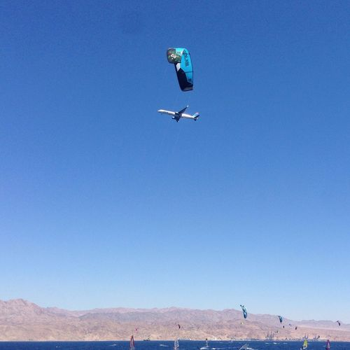 Deception Kitsurfing Surf Airplane Sky Blue Group Of People Nature Clear Sky Flying Land