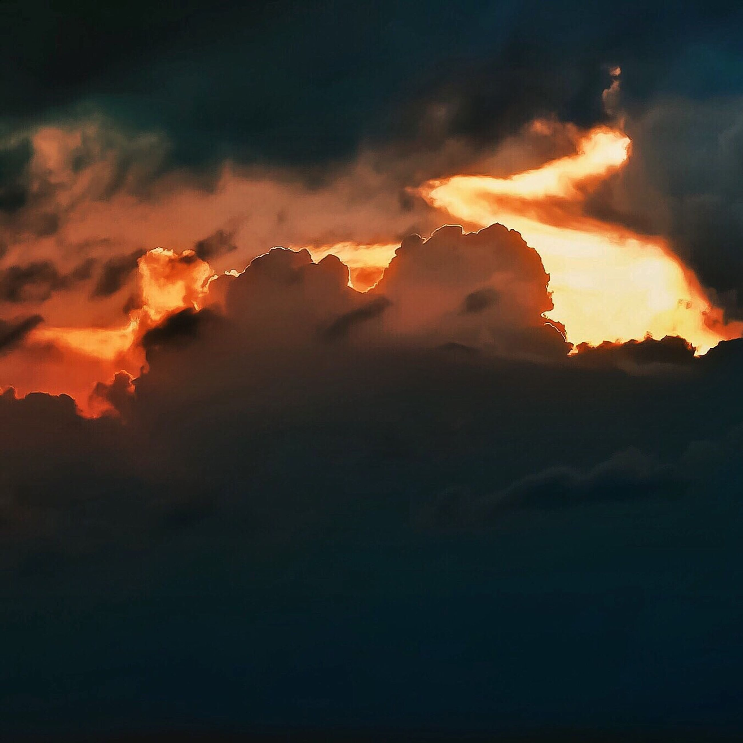 sunset, sky, orange color, scenics, cloud - sky, beauty in nature, dramatic sky, tranquil scene, tranquility, idyllic, nature, weather, cloudy, majestic, cloud, mountain, outdoors, cloudscape, overcast, no people, moody sky, landscape, non-urban scene, dark, glowing, remote