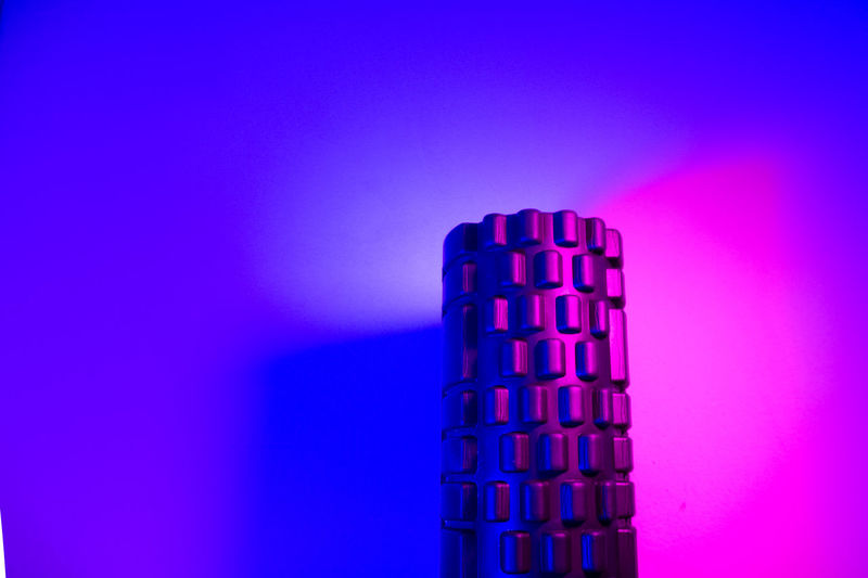 Close-up of metallic structure against blue background