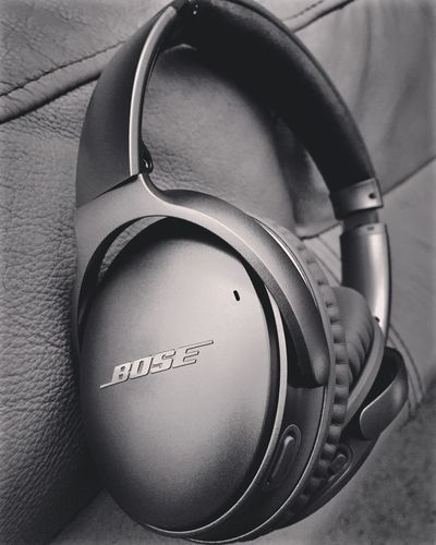 Indoors  Headphones Listening Close-up Technology Communication Music Arts Culture And Entertainment Audio Equipment Text Still Life High Angle View No People Western Script Leather Equipment Day Single Object Headwear Control