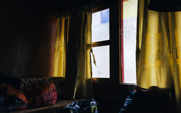 First morning on a long trek. Frost Orange The Week on EyeEm Trekking Absence Architecture Bed Bedroom Building Curtain Day Domestic Room Frosted Glass Furniture Hanging Home Interior House Indoors  No People Pillow Relaxation Sofa Textile Window Yellow