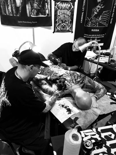 Tattoo Fest Tattoo Real People One Person Lifestyles Leisure Activity Three Quarter Length Glasses Men