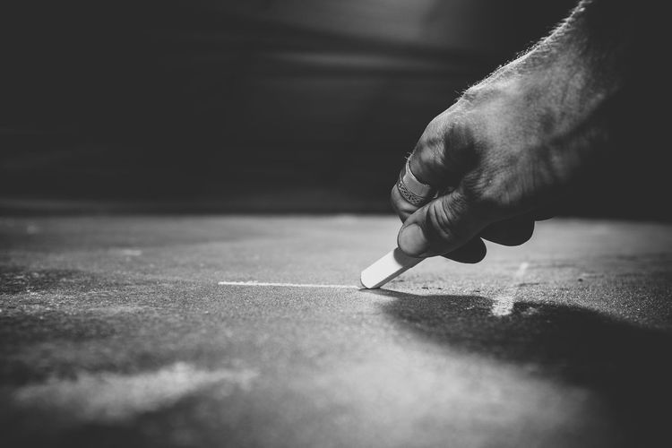 drawing the line Body Part Close-up Day Finger Flooring Hand Holding Human Body Part Human Hand Indoors  Leisure Activity Lifestyles Men Occupation One Person Real People Selective Focus Sunlight Table Writing