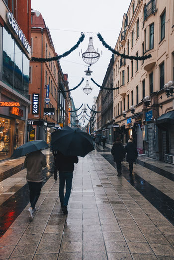 City Architecture People Sweden New Old Town Street Rain Architecture Day Outdoors Travel Destinations Built Structure Building Exterior Sky Pedestrian Adult Adults Only