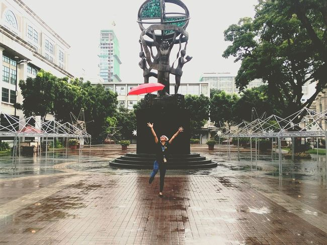 Playing Under the rain. Water Jumping Real People Tree Motion Full Length One Person Day Outdoors Refreshment People Adults Only Sky Only Men One Man Only Adult Red Umbrella Statues And Monuments Fun